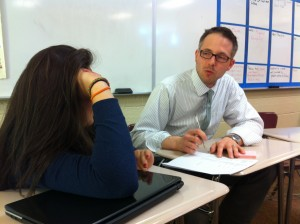Kurt Steiner works with a student at Grand River Preparatory High School