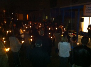People gather outside of Covenant House Academy of Grand Rapids to honor homeless youth