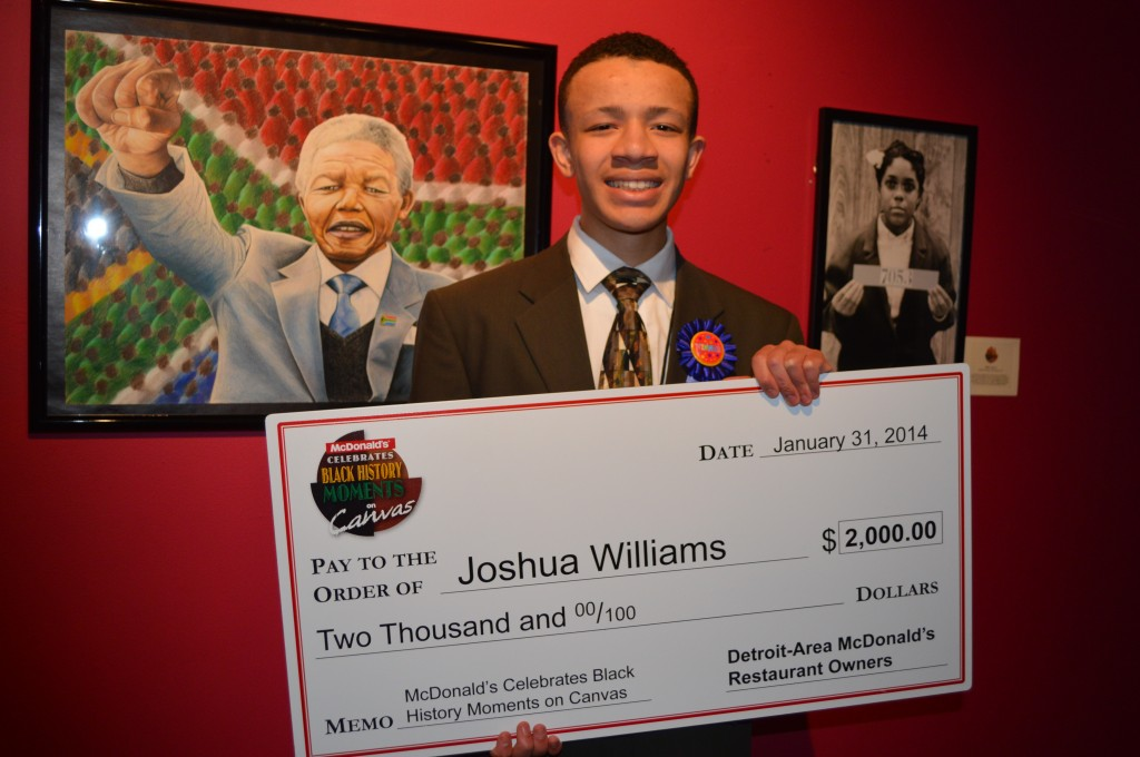 Joshua Williams in front of his award-winning art piece.